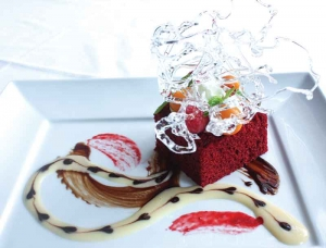 ade Red Velvet Cake - centered with Grand Marnier Chocolate ganash, complimented with an orange cream at Ascots.