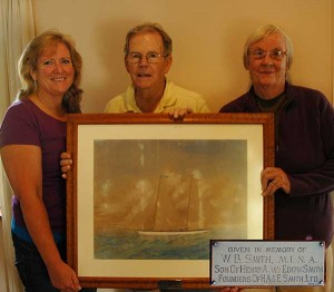 Roger Davidson, flanked by his wife Lee and his daughter Jennifer, presented the Edward James painting of a Bermuda Pilot Gig to the National Museum.